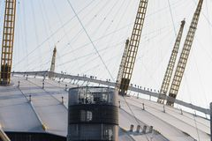 People climbing / walking on the O2 Arena entertainment dome's Roof Walk, a fabric walkway suspended from masts. royalty free stock photos