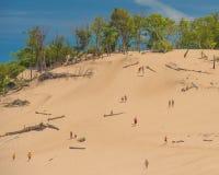 People climbing the Warren Dunes stock photos