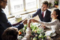 People Cling Wine Glasses on Wedding Reception with Bride and Gr Stock Photo