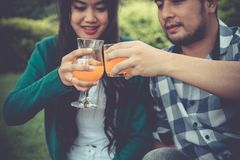 People clinging,toasting drinks together. hanging out with partn Stock Photos