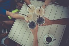 People clinging,toasting drinks together. royalty free stock images