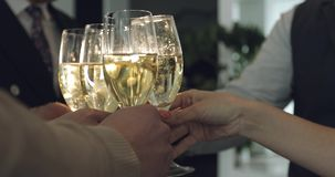 People clink glasses. Hands close up. Business women and men celebrate a holiday in a modern office stock video footage