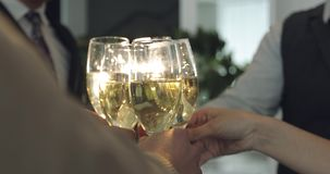 People clink glasses. A party in the office. Business people celebrate birthday. Close-up stock video