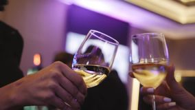 People clink glasses of wine. Close up view stock footage