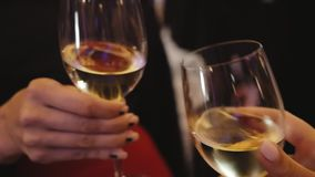 People clink glasses of wine. Close up view stock video