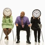 People with clock faces Stock Photo