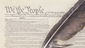 We the People. Close crop of the preamble to the United State`s Constitution with an eagle feather pen Stock Photo