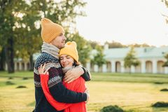 People and closeness concept. Young couple in love have date, embrace each other, feel support, being alone in park, have perfect. Relationships. Handsome men stock images