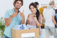 People with clothes donation gesturing thumbs up Royalty Free Stock Photography