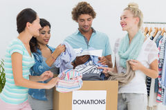 People with clothes donation Stock Images