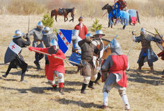 People in clothes of medieval soldiers combat Royalty Free Stock Photo