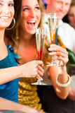 People in club or bar drinking champagne Royalty Free Stock Photography