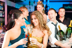 People in club or bar drinking champagne Stock Images