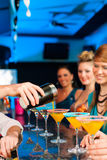 People in club or bar drinking cocktails stock photos