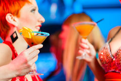 People in club or bar drinking cocktails Stock Photo