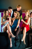 People in club or bar drinking cocktails. Young people in club or bar drinking cocktails and having fun royalty free stock image