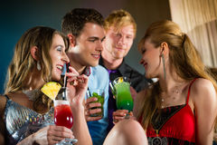 People in club or bar drinking cocktails. Young people in club or bar drinking cocktails and having fun stock photography
