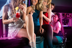 People in club or bar drinking cocktails Royalty Free Stock Image