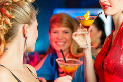 People in club or bar drinking cocktails Royalty Free Stock Images