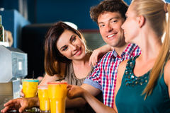 People in club or bar drinking Royalty Free Stock Photo