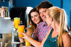 People in club or bar drinking Stock Image