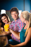 People in club or bar drinking Stock Photo