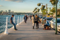 People on the coast of Bosphorus in Istanbul, Turkey Royalty Free Stock Image