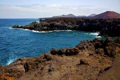 People   coastline stone volcanic spain  water  in lanzarote Stock Photo