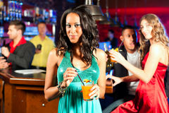 People with cocktails in bar or club Royalty Free Stock Images