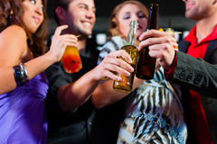 People with cocktails in bar or club Royalty Free Stock Photos