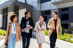 People with coffee and conference badges in city Royalty Free Stock Image
