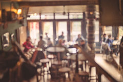 People in Coffee shop blur background. With bokeh lights, vintage filter for old effect, blurred background Royalty Free Stock Image
