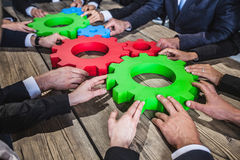 People with cogs of business. Business people with cogs of business, modern business meeting concept Royalty Free Stock Photos