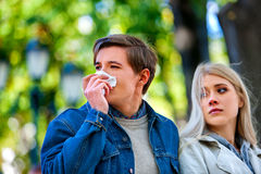 People with  cold blowing nose  handkerchief fall Royalty Free Stock Photo