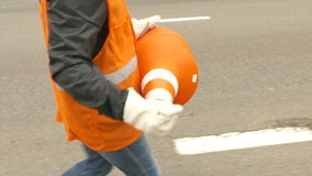 People collect cones from the road stock footage
