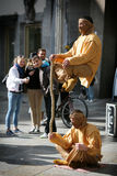 People on the Cologne street looking at the magic indian artists in orange clothes Royalty Free Stock Photography