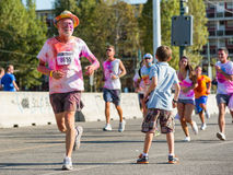 People at the Color Run 2013 in Milan, Italy stock photography