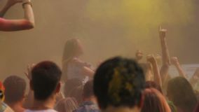 People colored with powder paint dancing at open-air concert, Holi festival. Stock footage stock video footage
