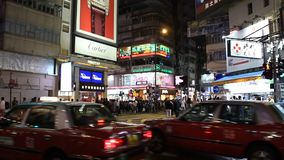 People and colorful shops at night in Hong Kong stock video