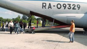 People come into the cargo plane at an open day at the aerodrome Migalovo stock video footage