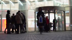 People come and leave the main shopping center of the city stock footage