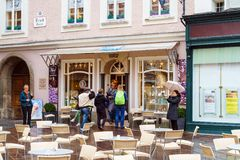 People come in and out of the confectionery Furst, Salzburg, Austria stock photography