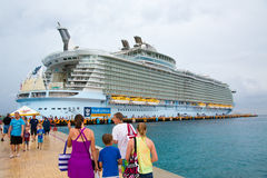 People Coming and Going to Cruise Ship. People on the pier with the cruise ship in the background stock photo
