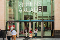 People coming out and going in the Queens Arcade, Cardiff Stock Photography