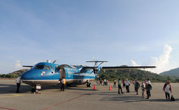 People coming to the aircraft at Condao airport in Vungtau, Vietnam Stock Image