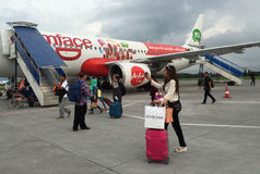 People coming to the airplane at airport in Jogja, Indonesia.  Stock Photography