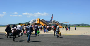 People coming to the airplane at Cat Bi airport in Haiphong, Vietnam Stock Photo