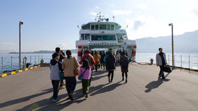 People coming to the boat in Hiroshima, Japan Royalty Free Stock Photo