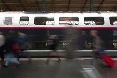 People coming to or leaving train station platform. Stock Images