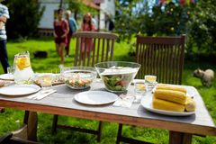 People coming to table with food at summer garden royalty free stock photography